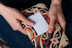 Woman holding white card. mock up design stock photos