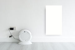 Mock up white discard with Cleaning robot charging Royalty Free Stock Photo