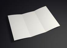 Mock up white folded paper on black background Royalty Free Stock Images