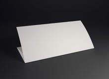 Mock up white folded paper on black background Royalty Free Stock Photos