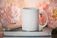 Mock-up of a white mug. With some feminine stuff. For women`s gifts creators Royalty Free Stock Photos