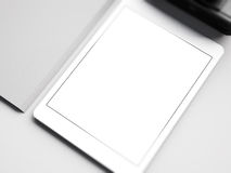 Mock up of white tablet on the workspace. 3D Royalty Free Stock Image
