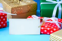 Mock up white text label and gift boxes on the wood table. With the holiday season Royalty Free Stock Photography