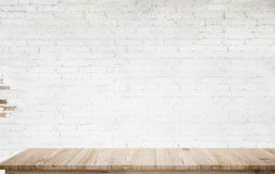 Mock up wooden table with white brick wall. For product display montage Stock Photography