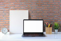 Mock up workspace and copy space. Mock up Blank screen laptop and poster frame on desk stock photo