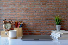 Mock up workspace and copy space. Workspace mockup laptop and supplies on white table Royalty Free Stock Image
