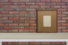Mock up Workspace vintage frame hipster interior. Workspace Mock up frame hipster interior red brick wall with wooden desk vintage royalty free stock photo