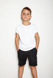 Mock up of young boy wearing black shorts Royalty Free Stock Images