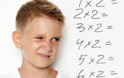 Mock up of young kid thinking about some homework Stock Image