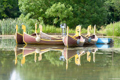 Mock viking row boats on lake. For hire in summer Royalty Free Stock Images