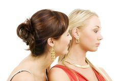 Mockery. Picture of two young girlfriends over white Stock Images