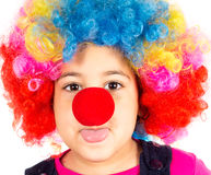 Mockery clown. Funny little child with clown wig and red nose mockering stock images
