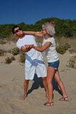 Mocking quarrel at a beach Royalty Free Stock Image