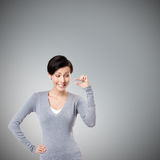 Mocking woman gestures small amount Stock Photos