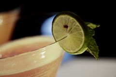 Mocktail with Lime Slice and Peppermints leaf Royalty Free Stock Photos