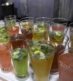 Mocktails glasses garnished with lemon and mint royalty free stock photos