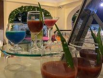 Mocktails on Martini glass teble stock photos