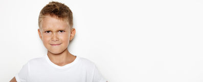 Mockup of angry young boy on the white background Royalty Free Stock Image