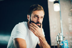Mockup of a bearded man wearing white tshirt and Royalty Free Stock Photos
