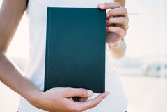 Mockup of black book in hands Stock Photo