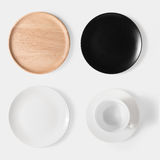 Mockup black dish, white dish, wooden plate and cup of coffee se. T isolated on white background. Copy space for text and logo. Clipping Path included on white Stock Image