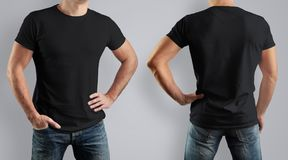 Mockup  black t-shirt on strong man on gray background. Front vi. Mockup  black t-shirt on strong man on gray background. Template for presentation of clothes Stock Photo