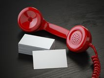 Mockup of  blank business cards and  red retro phone receiver  o. N  the black wooden desk background. 3d illustration Stock Photos