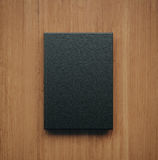 Mockup of blank classic black book. 3d rendering Stock Image