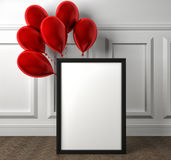 Mockup of blank frame poster and red balloons on the floor. Stock Images