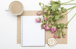 Mockup with blank notepad, cup of coffee and little garden pink roses. Morning still life. Royalty Free Stock Photos
