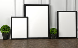 Mockup of blank three frame poster on the floor Royalty Free Stock Images