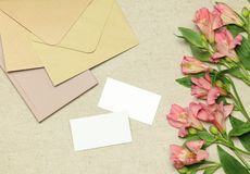 Mockup business card with flowers, notes, envelopes royalty free stock photography