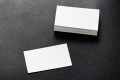 Mockup of business cards stack at dark background. Design concept. Template for branding identity. Mockup of business cards at dark background royalty free stock image