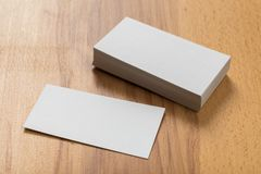 Mockup of business cards stack at wooden background. Design concept. Template for branding identity. Mockup of business cards at wooden background stock photography