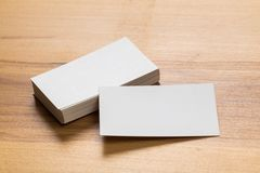 Mockup of business cards stack at wooden background. Design concept. Template for branding identity. Mockup of business cards at wooden background stock photos