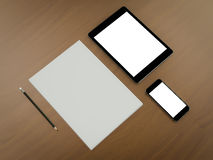 Mockup business template. Set of elements on the braun wooden table. Royalty Free Stock Photos