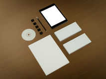 Mockup business template. Set of elements on the braun wooden table. Mockup business template. High resolution Royalty Free Stock Images