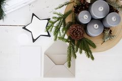 Mockup Christmas card. Christmas card mockup on wooden desktop stock photo