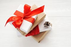 Mockup Christmas Gift Box On Wooden Background With Snowflakes, Greeting card Merry Christmas and Happy New Year Royalty Free Stock Images