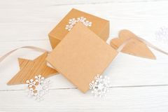 Mockup Christmas gift boxes with wooden star and heart, with space for your text royalty free stock image