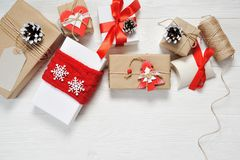 Mockup christmas vintage gift box package with blank gift tag on old wooden background. Flat lay, top view photo mock up.  Royalty Free Stock Photo