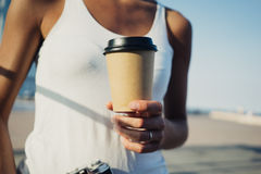 Mockup of coffee cup in girl hands Royalty Free Stock Images