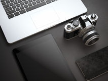 Mockup with computer, camera and tablet on black floor Stock Photography