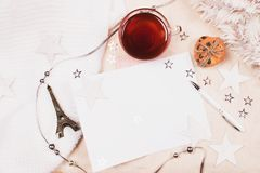 Mockup with a cup of tea, card and pen on fabric background. stock images