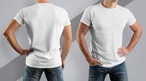 Mockup  for the design of clothes. Young man, front view and ba. Young man, front view and back, in a white cotton T-shirt on a gray background. Mockup  for the Stock Photos