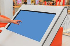 Mockup of digital white screen panel and man`s hand. Blank modern media billboard in the shopping center. Place for text, advertising or public information royalty free stock photos