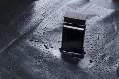Mockup of elegant bottle of perfume on water drops background.Concept of moonlignt tones. stock image