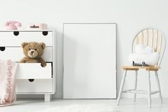 Mockup of empty poster and cabinet with plush toy and pink blank Royalty Free Stock Photography