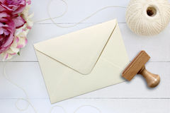 Mockup of envelope with a rubber stamp next to it. Royalty Free Stock Photography