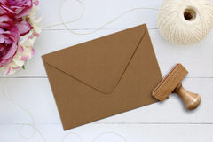Mockup of envelope with a rubber stamp next to it. Royalty Free Stock Images